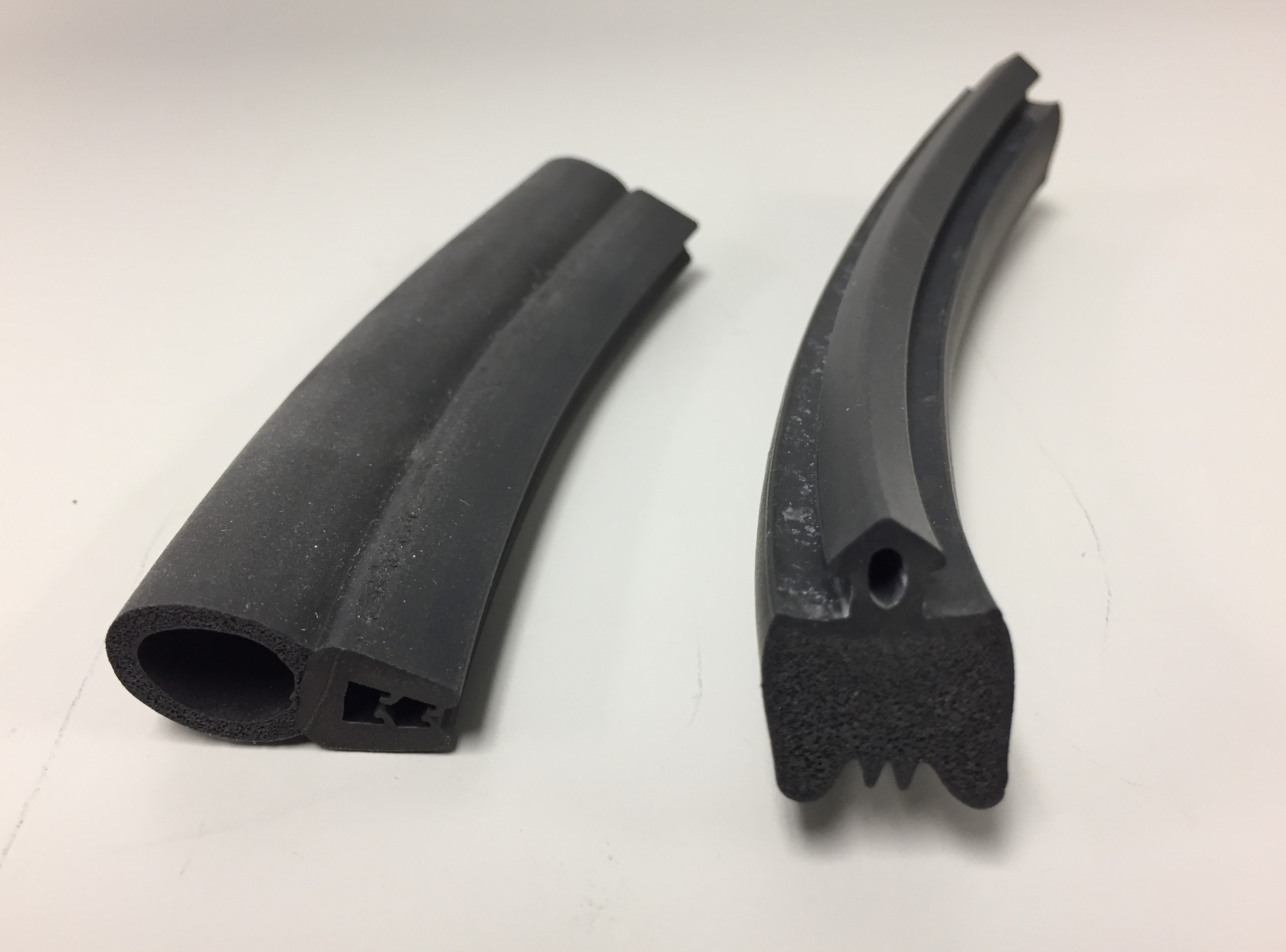 A pair of co-extruded rubber and sponge rubber components for sealing applications.
